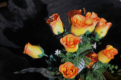 Artificial flowers on the grave Royalty Free Stock Images