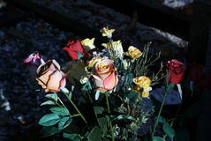 Artificial flowers on the grave Stock Image