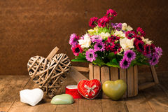 Artificial flowers and heart shape Royalty Free Stock Images