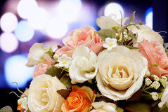 Artificial flowers on light blurred bokeh background. Royalty Free Stock Photography