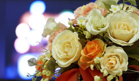 Artificial flowers on light blurred bokeh background. Stock Photos
