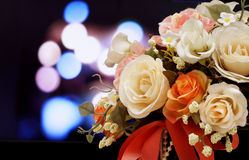 Artificial flowers on light blurred bokeh background. Stock Photo