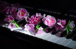 Artificial flowers. Music synthesizer royalty free stock photography