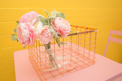 Artificial flowers on pink table. Pastel Royalty Free Stock Photography