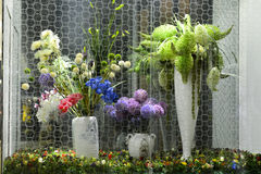 Artificial flowers and plants in glass case Stock Photography