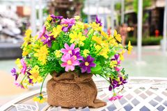 Artificial  flowers in a sack Royalty Free Stock Images