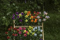 Artificial flowers. For sale near cemetery fence Stock Images