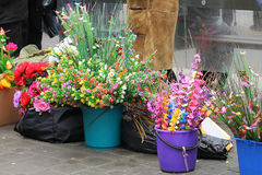 Artificial flowers are sold on Palm Sunday Royalty Free Stock Photography