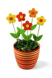 Artificial flowers in striped pot Stock Photos