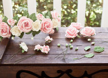 Artificial flowers on table Stock Photo