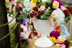 Artificial flowers in a vase. Large bouquet. Artificial flowers in vase decoration wedding royalty free stock image