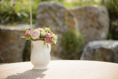 Artificial flowers in a vase Stock Photography
