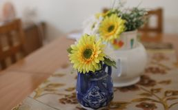 Artificial flowers in vases on the table royalty free stock photo