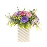 Artificial flowers in white vase on isolated  background Stock Photo