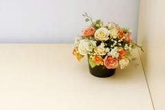 Artificial flowers on wood table Royalty Free Stock Photography