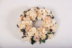 Artificial flowers wreath  on white Royalty Free Stock Photo