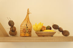 Artificial fruit basket on wooden board Stock Photos