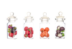 Artificial fruit and vegetable in the bottle isolated on white Stock Photo