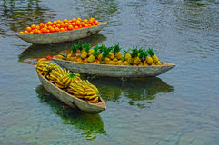 Artificial fruits on boats Stock Image