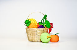 Artificial fruits in tiny basket Stock Photography