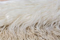 Artificial fur background white, brown, beige, cream Royalty Free Stock Images