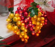 Artificial grapes glowing. As wedding table decoration Royalty Free Stock Photography