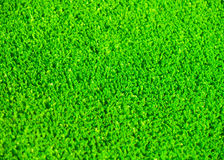 Artificial grass. A background of green artificial grass Royalty Free Stock Photo