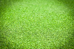 Artificial grass. Background with vignetting added Royalty Free Stock Photos