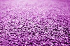 Artificial grass with blur effect in purple tone