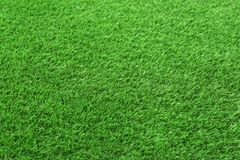 Artificial grass carpet as background, closeup. Exterior element royalty free stock photography