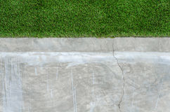 Artificial grass on a cement wall Royalty Free Stock Image
