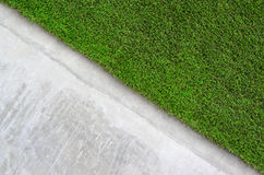 Artificial grass on a cement wall Royalty Free Stock Photos