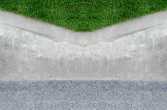 Artificial grass on a cement wall Royalty Free Stock Photo