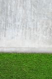Artificial grass on a cement wall Stock Photo