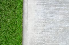 Artificial grass on a cement wall Stock Images