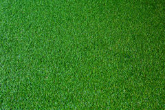 Artificial Grass,grass. Artificial turf is a surface of synthetic fibres made to look like natural grass. It is most often used in arenas for sports that were Stock Photo