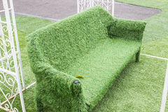 Artificial grass outdoor sofa. In white curved steel Royalty Free Stock Photo