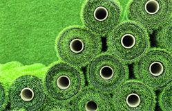 Artificial grass in rolls to cover tennis courts, sports fields, golf courses and football.  royalty free stock images