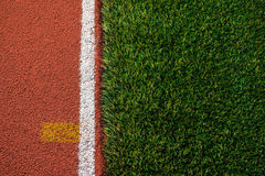 Artificial grass and run track texture Royalty Free Stock Image