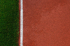 Artificial grass and run track texture Stock Images