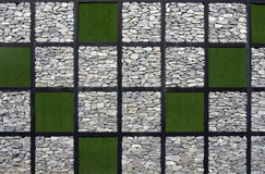 Artificial grass and stone pattern wall. Royalty Free Stock Photography