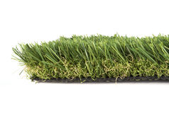 Artificial grass on a white Stock Photo
