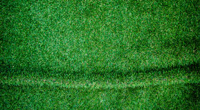 Artificial grass wrinkled background.For art texture or web desi Royalty Free Stock Image
