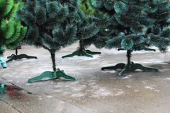 Artificial green Christmas tree on the pavement Royalty Free Stock Photography