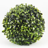 Artificial green flowers. On white Stock Photo