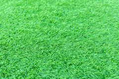 Artificial green grass or astroturf for background. Dept of field with artificial green grass or astroturf for background stock image