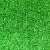Artificial green grass texture or green grass background for golf course. soccer field or sports background royalty free stock photography