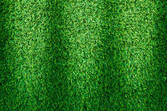 Artificial green grass texture for golf course. soccer field or royalty free stock images