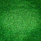 Artificial green grass texture or green grass background for golf course. soccer field or sports background stock photo
