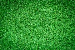 Artificial green grass texture or green grass background. stock photos
